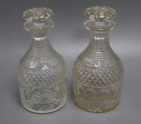 A pair of Georgian cut glass decanters and stoppers height 23cm