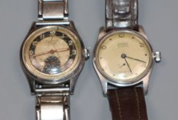 A gentleman's 1950's? steel Dixton manual wind wrist watch and a Rodana manual wind wrist watch.