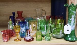 A collection of Mary Gregory style coloured enamelled glassware, including a green frilled vase,