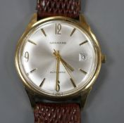 A gentleman's late 1960's 9ct gold automatic wrist watch, retailed by Garrard, with baton numerals