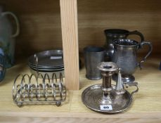 A Victorian silver plated chamberstick, pewter tankards, plates and a toast rack