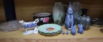A quantity of Denby jugs, a Denby water bottle by Gilbert, a Doulton vase, a Victorian cow creamer