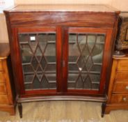 A mahogany concave front display cabinet W.102cm