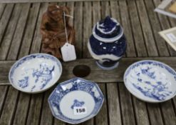 A pair of Chinese blue and white dishes and another, 18th century, a carved deity and a dragon vase