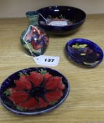 A Moorcroft Anemone small bowl, a similar pin dish, a small Hibiscus vase and a Clematis pin dish (
