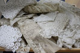 A fine mixed needle lace and Anglaise pillowcase, a needle run stole and various lace collars,