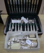 Three silver napkin rings (two boxed), a canteen of Oneida Community Beethoven pattern flatware