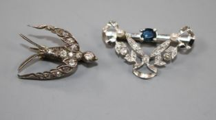 A Victorian yellow and white metal, diamond set swallow brooch and a later diamond and sapphire