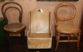 A 19th century pine child's rocking chair and two later cane seat childs chairs