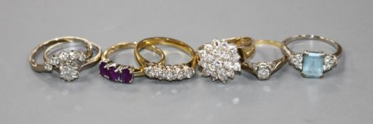 Four 18ct gold and diamond set dress rings, an 18ct gold aquamarine and diamond dress ring and two