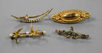 Four assorted early 20th century yellow metal and gem set brooches, including twin swallow and one
