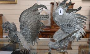 A pair of metal cockerels