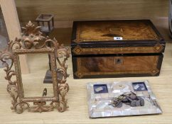A Victorian burr walnut writing slope, a mother of pearl inkstand, a frame and a miniature lamp