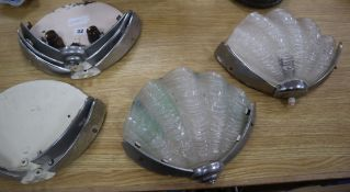 A pair of Art Deco 'Shell' wall lights with shades and five others