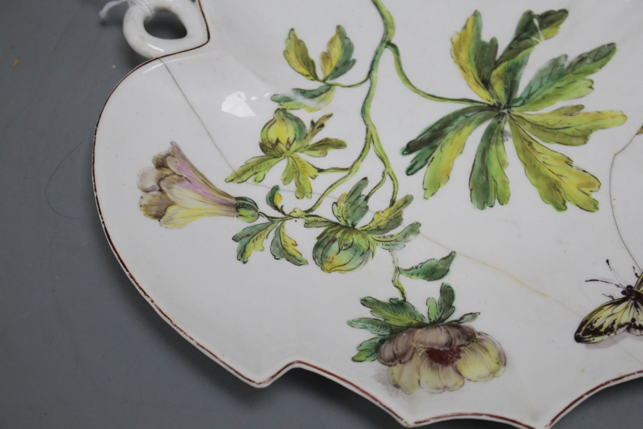 Lot 89 - A rare Chelsea red anchor 'Hans Sloane' botanical dessert dish, c.1755, length 22.5cm Condition: The