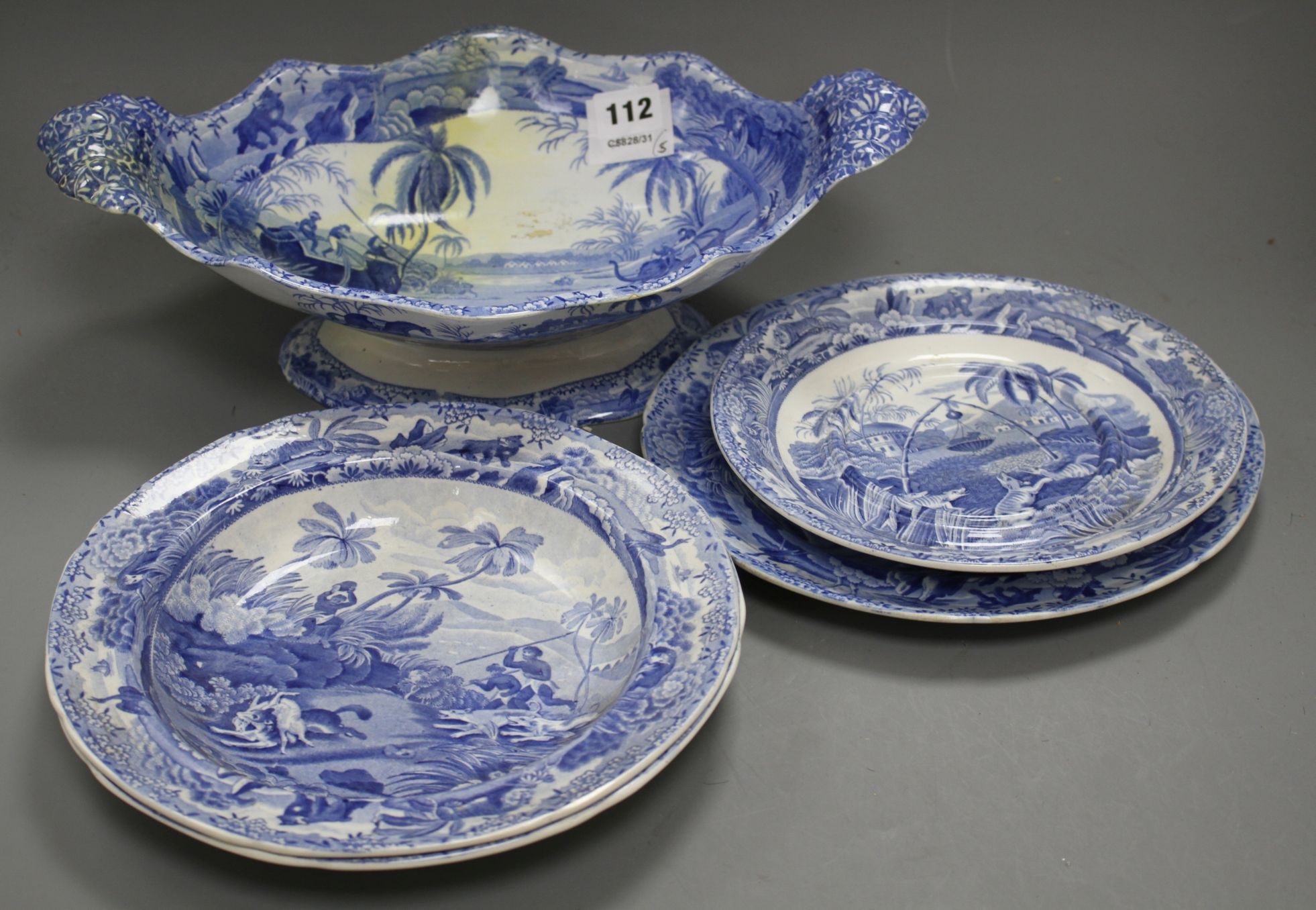 Lot 112 - Three Spode Indian Sporting Series blue and white plates, a stand and a footed dish, c. 1815- 25,