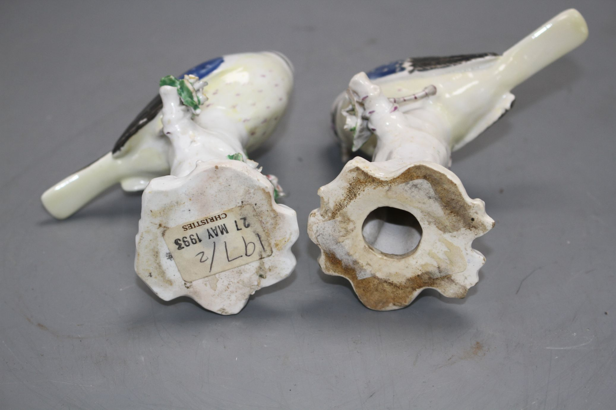 Lot 95 - A pair of Derby figures of blue tits on tree stumps, c.1765-70, height 11.7cm and 11.5cm Note: Ex