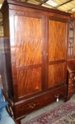 A 1920s George III-style mahogany wardrobe, W.134cm, D.52cm, H.206cm