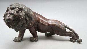 A Japanese bronze lion, length 35cm
