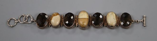 A white metal, oval smoky quartz and oval hardstone set bracelet, approx. 20.5cm, gross 81.5 grams.