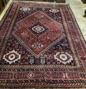 A Caucasian geometric red ground carpet, 320 x 230cm