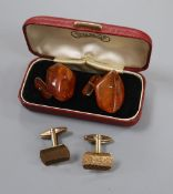 A pair of 9ct gold cufflinks, 6.1 grams and a pair of amber cufflinks.