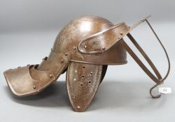 A reproduction English Civil War lobster tail helmet, length 49cm approx.