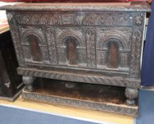 An 18th century and later carved oak fall front cabinet, (altered) W.127cm, D.51cm, H.104cm