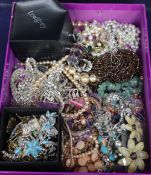 A group of assorted costume jewellery including rings, brooches, necklaces, etc.
