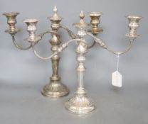 A pair of plated two branch candelabra