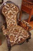 A Victorian rosewood spoon back open armchair