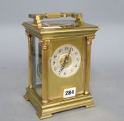 An early 20th century French lacquered brass oversized carriage clock, striking on a gong,