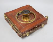 A Ross, London mahogany and brass half plate camera, plaque reading 'Presented by the Lords