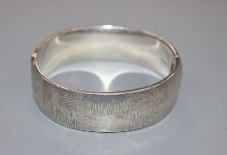 A modern textured silver bangle, Birmingham, 1971, 45 grams.CONDITION: Overall good condition.
