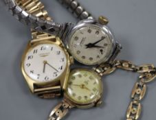 A lady's 9ct gold Tudor manual wind wrist watch and two others.