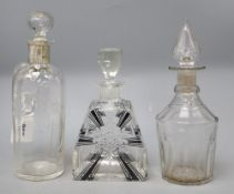 A silver mounted glass claret jug etched 'Whisky', height 26cm, an Art Deco decanter and another