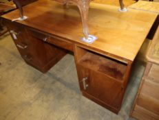 An Art Deco style chrome mounted walnut pedestal desk, W.150cm, D.75cm, H.75cm