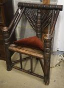 A 19th century turner's chair, with triangular seat and ball-turned spars to back