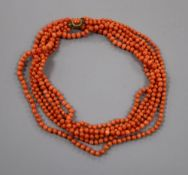 A triple strand graduated coral bead necklace, with gilt metal clasp, 86cm, gross weight 81 grams.