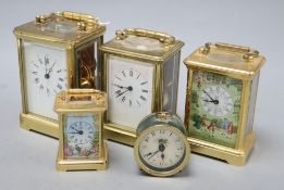 An Asprey brass cased carriage clock, another carriage clocks, two Halcyon Days carriage