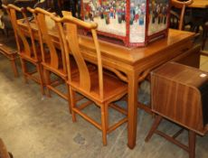 A Chinese dining table and six chairs, table W.216cm, D.86cm, H.84cm