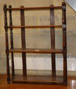 A Victorian mahogany three tier wall shelf with round finials, W.62cm, D.18cm, H.80cm