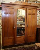A late Victorian aesthetic movement walnut compactum wardrobe, W.185cm, D.58cm, H.222cmCONDITION: