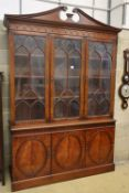 Charles Barr Furniture, A Sheraton-style mahogany library bookcase with swan-neck pediment, W.154cm,
