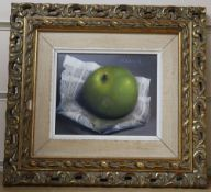 G. Reekie, oil on board, Still life of an apple and newspaper, signed, 11 x 13.5cm