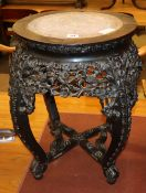 A 19th century Chinese marble topped carved hardwood jardiniere stand, diameter 44cm, H.53cm