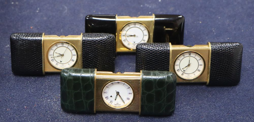 Lot 457 - Four Nepro gilt metal cased purse alarm watches, with easel backs, each 56mm., three with leather