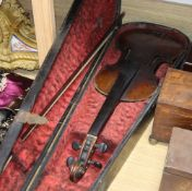 A late 19th century German violin, bears Stradivarius label, cased with bow, back 36cm