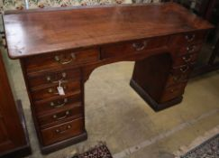 A George III mahogany clerk's desk, W.162cm, D.60cm, H.97cmCONDITION: The top is bruised, stained