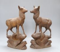 A pair of Black Forest carved deer, c.1860, height 34cm